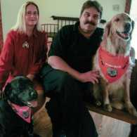Stephen, Gwen and their pups in the Dog Chapel.