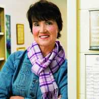 A portrait of Jayne Bowers leaning against the Social Sciences department office.