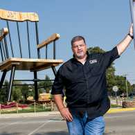 Jim Bolin in front of the World's Largest Rocking Chair; photo by Michael D. Tedesco