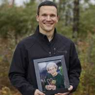 John Haney with a photo of his grandmother; photo by Natalia Weedy
