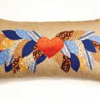 A pillow crafted with love, made with fabric swatches sent by her grandmother