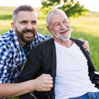 A male caregiver with his father.