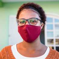 A woman wearing a mask; Getty Images