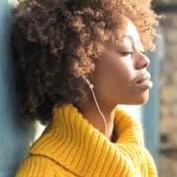 A woman listening to music; Getty Images