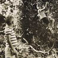 The lifesaving photo of Doug climbing a muscadine vine as Buddy Earl looks on
