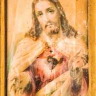 A portrait of Jesus in a gold frame; Photo credit: STEPHEN BARNES/ALAMY