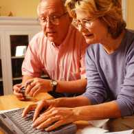 A mature couple goes over their finances together