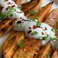 Sam Sifton's Honey-Roasted Sweet Potatoes With Yogurt Sauce; photo by Kevin Eans