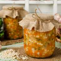 Mason jars for barley and vegetable soup with some ingredients used.