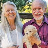 Beth and Ross pose with Sunny, a petite goldendoodle; Photo courtesy: Beth Kingsley Hawkins