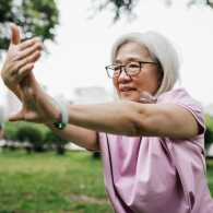 A woman doing Tai chi outdoors.