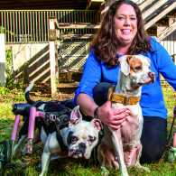 Sasha Corbett with some of her handicapped rescue dogs: Rosalie, Tipsy and Lana