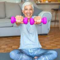 Woman exercises with weights