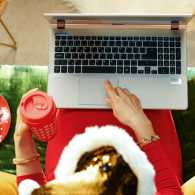 Woman celebrating holidays virtually; Getty Images