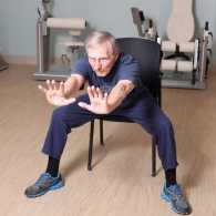 Ed demonstrating his physical therapy exercise.