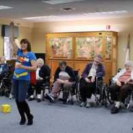 Volunteer Lisa Alden playing a game with the senior citizens of the Good Samaritan Society