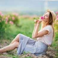 Woman smelling summer flowers