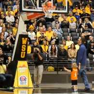 Titus sinks a bucket during halftime of a college basketball game.