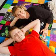 Lucas and Lisa Wasinger pose with their Minecraft quilt
