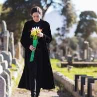 A woman at a cemetery