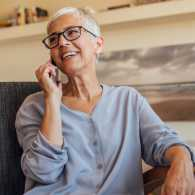 Woman smiling while on the phone