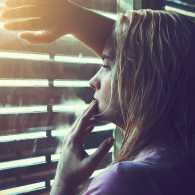 Sad woman looking out the window