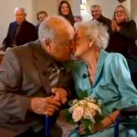 Couple kiss while renewing wedding vows.