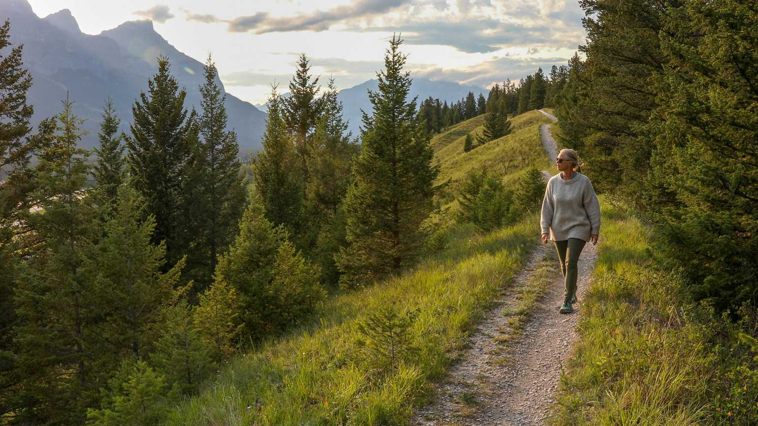 A woman taking a scenic stroll outdoors; Getty Images