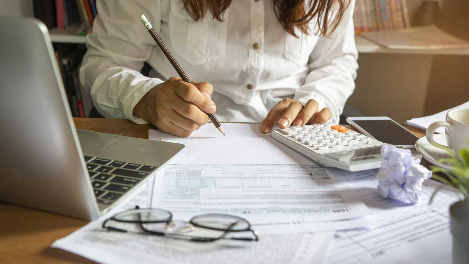 A woman doing her taxes.