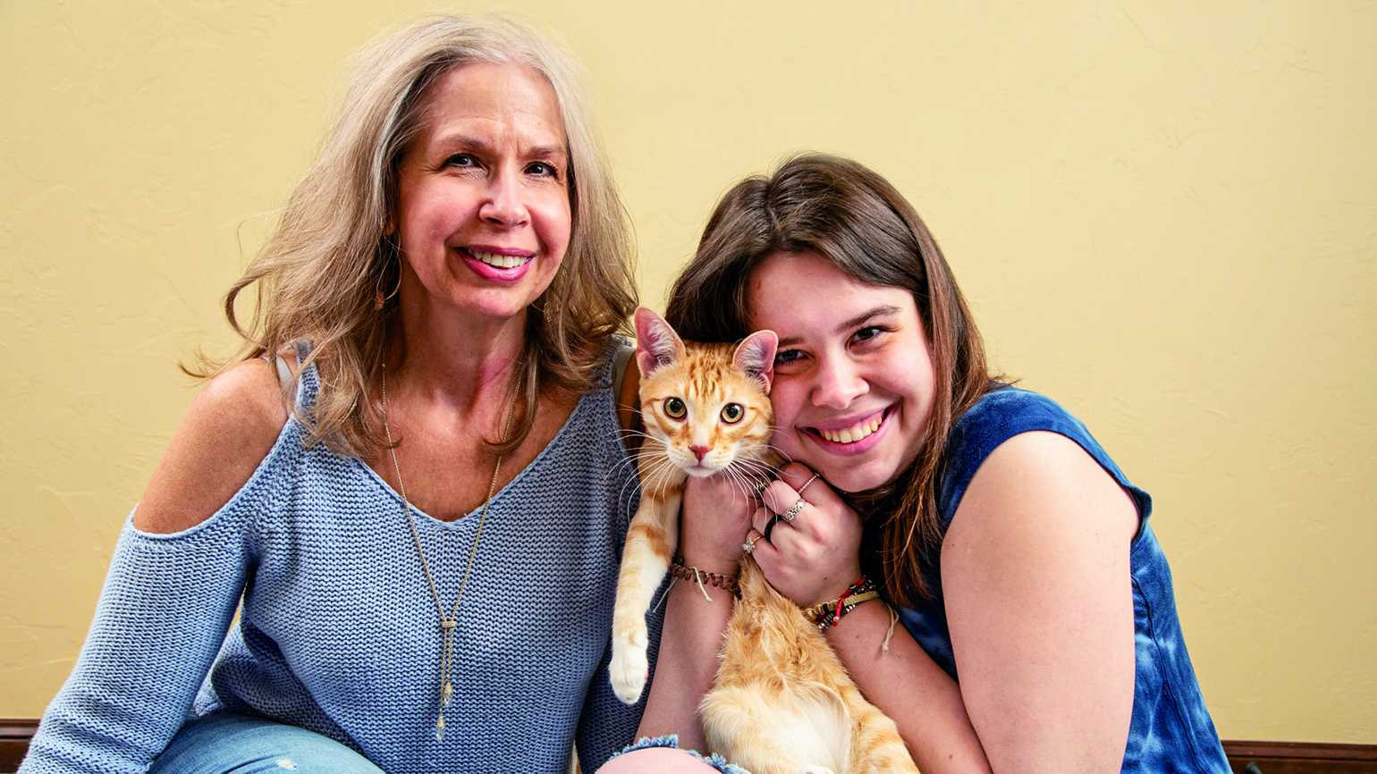 Micah Thompson and her cat, Ron, and mother Stephanie