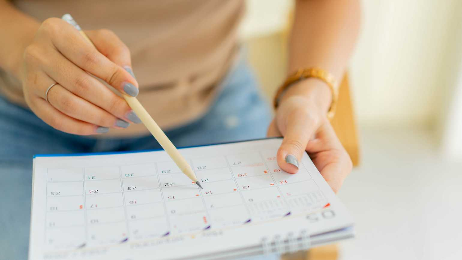 Schedule time on a calendar; Getty Images