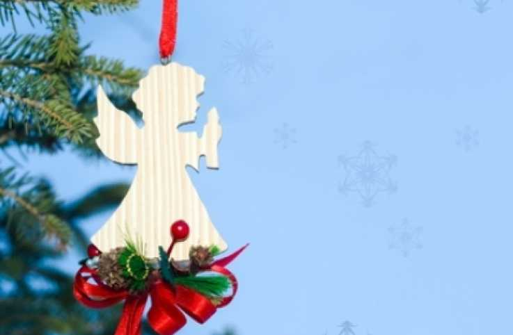 an angel ornament in a Christmas tree