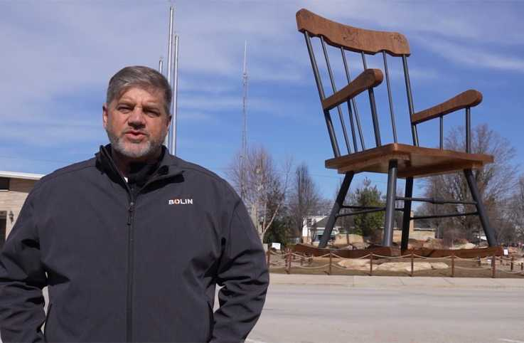 Jim Bolin in front of the World's Largest Rocking Chair in Casey, Illinois