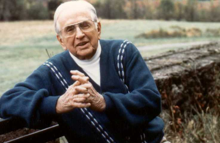 A portrait of Norman Vincent Peale outdoors.