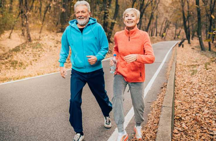A senior couple running on a trail; Getty Images