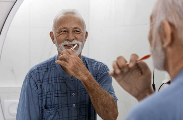 Senior brushing his teeth; Getty Images