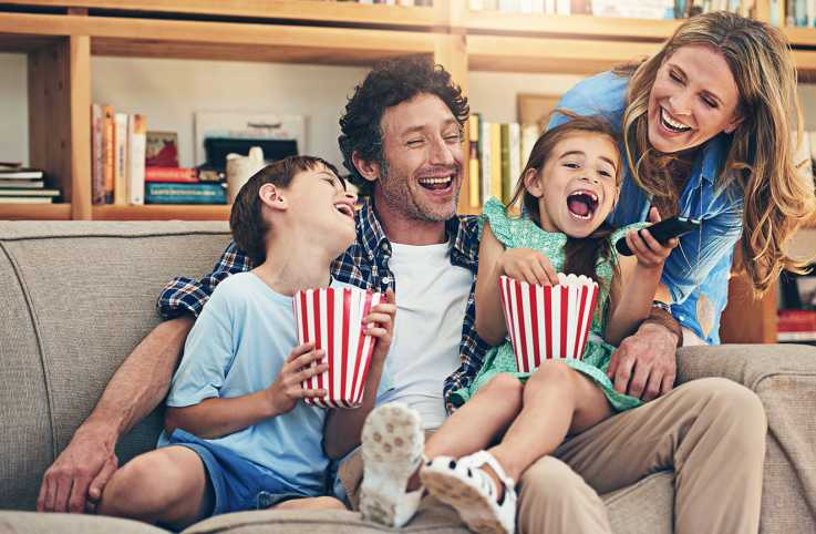Family enjoying a movie together