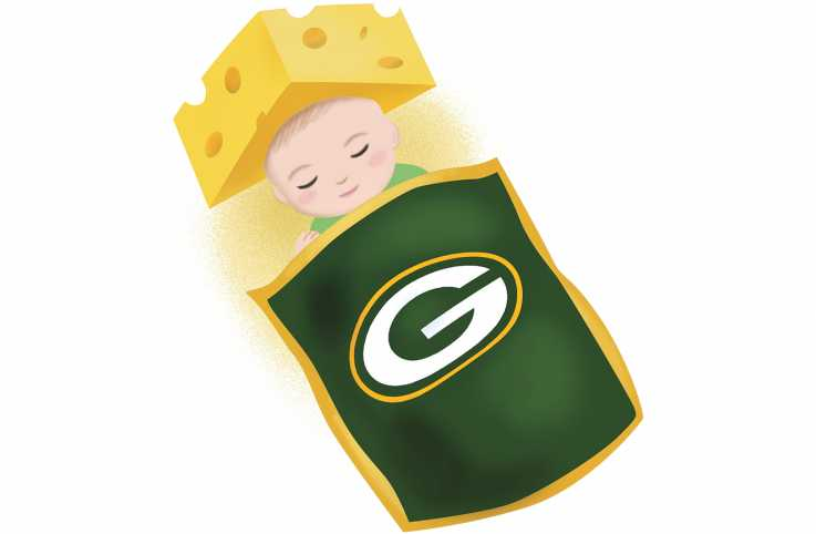 A baby in Green Bay Packers merchandise and a cheesehead hat.