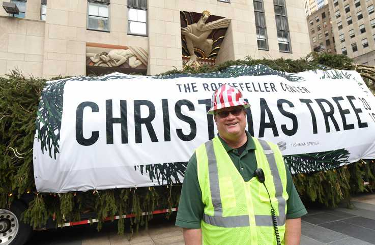 Erik Pauze with 2019 Rockefeller Center Christmas tree; Diane Bondareff/AP Images for Tishman Speyer