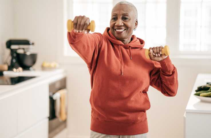 Woman exercising in her kitchen