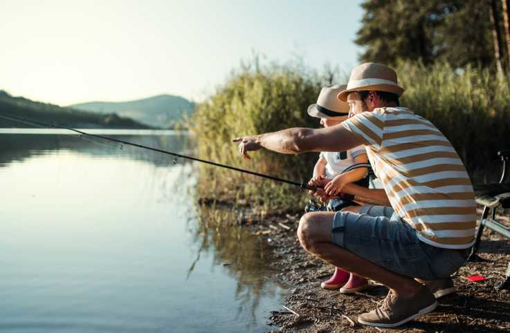 A father and son go fishing.