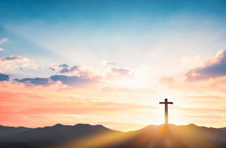 A cross with beautiful sky overhead; Getty Images