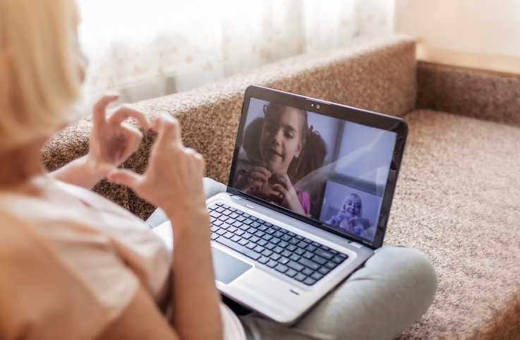 A woman video chatting with her granddaughter.