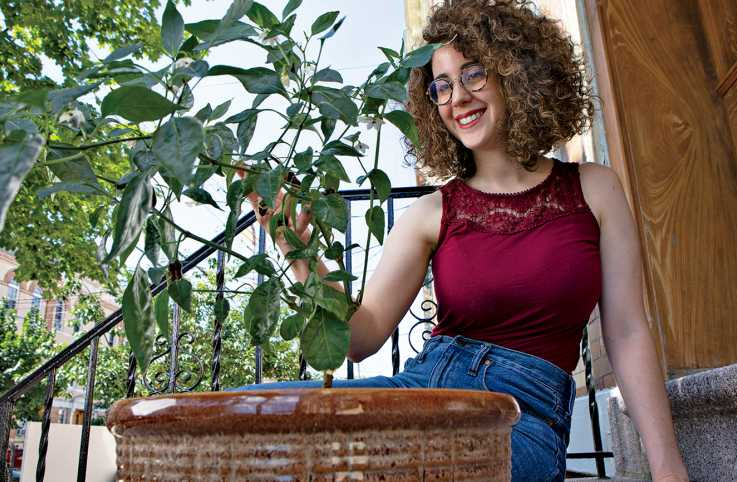 Mari Pack with her jalapeño plant; photo by Erica Seryhm Lee