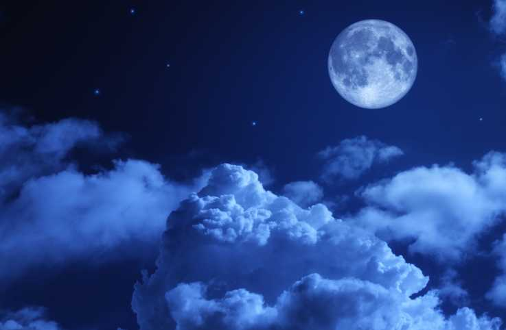 Moon and clouds in the night sky