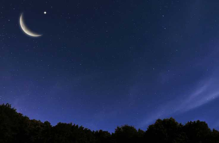 Night sky with crescent moon and stars; Getty Images