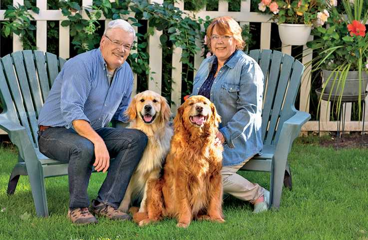Peggy Frezon with her husband Mike, and her therapy dog Ernest. Photo by Roy Gumpel