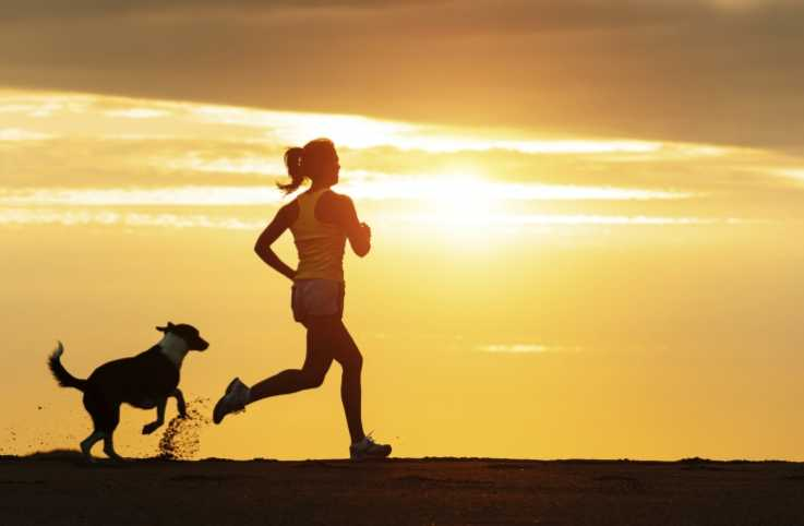 Woman running in sunset inspired by Bible verses to reach her goals