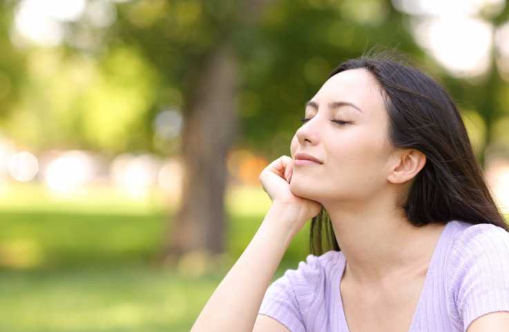 Woman resting relaxing in a park (Getty Images)