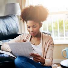 A woman works on her financial planning